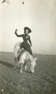 Woman circus performer on bowing horse