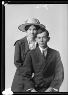 Portraits of Mr. and Mrs. James Hill and child