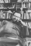 Rabbi Zalman Schachter in his office smiling while talking on the telephone, pt. 5 of 7.