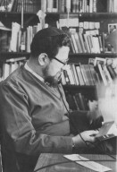 Rabbi Zalman Schachter in his office looking at correspondence while talking on the telephone, pt. 6 of 7.