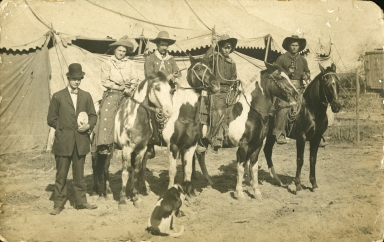 Women and men in Wild West Show costumes