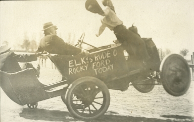 Rodeo clown riding jalopy
