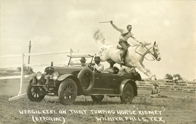 Virgil Keel jumping horse over car
