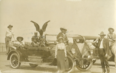 Leonard and Mayme Stroud and group in decorated car