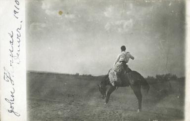 John Thomas riding bronco