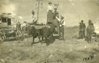 Mayme Stroud with ox cart and stagecoach