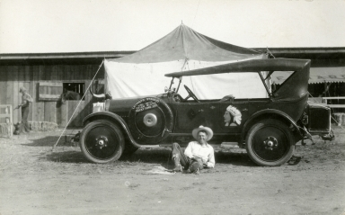 Trick rider Leonard Stroud with decorated car