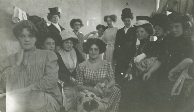 Mayme Stroud in circus costume with other women performers, backstage