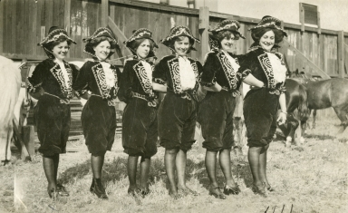 Mayme Stroud in costume with other fancy riders in Sells-Floto Circus