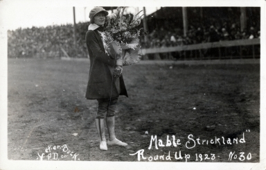 Mabel Strickland with bouquet of flowers at the Pendleton Round-Up