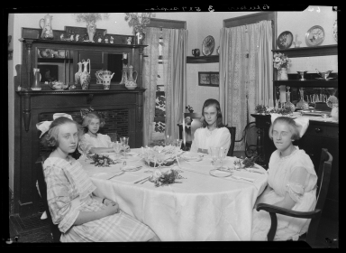 Children of Mrs. Bleeker, sitting at table