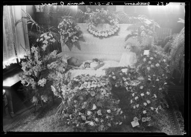 Portraits of deceased child of Jackson (Erickson) in coffin
