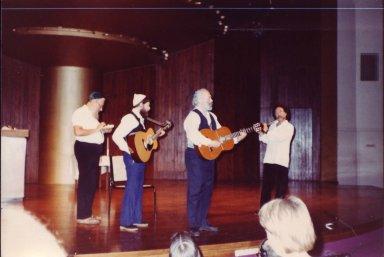 Rabbi Zalman Schachter, Rabbi Shlomo Carlebach, David Zeller and Paul Horn performing on stage at the Transpersonal Association Conference, 1982.