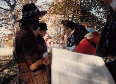 Rabbi Zalman Schachter-Shalomi with a baby carrier reading from a Torah scroll at a Simhat Torah retreat in 1981 (5742), pt. 3 of 3.