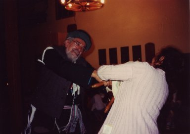 Rabbi Zalman Schachter-Shalomi (the other being unidentified) dancing with the Torah scroll on Simhat Torah at Fellowship House Farm.