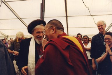 The 14th Dalai Lama (Tenzin Gyatso) and Rabbi Zalman Schachter-Shalomi after greeting one another at the Spirituality and Education Conference at the Naropa Institute in 1997, pt. 2 of 2.
