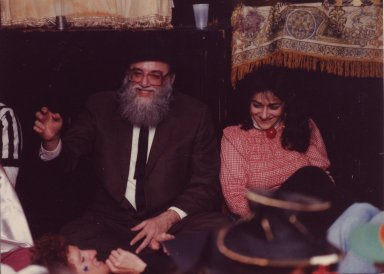 Rabbi Arthur Waskow, seated, with two unidentified women, pt. 1 of 4.
