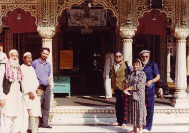 Rodger Kamenetz, Dr. Nathan Katz, Blu Greenberg and Rabbi Zalman Schachter-Shalomi with the keepers of the grave (dargah) of the Sufi saint, Nizamuddin Awliya, October 22, 1990, pt. 8 of 15.