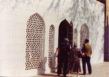 Rabbi Zalman Schachter-Shalomi, Blu Greenberg, and Dr. Nathan Katz entering the dargah (grave site) of the Sufi saint, Hazrat Inayat Khan, October 22, 1990, pt. 10 of 15.