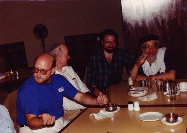 Dr. Nathan Katz, Rabbi Yitz Greenberg, Rabbi Moshe Waldoks and Rabbi Zalman Schachter-Shalomi at dinner in Karnal, India on October 22nd, 1990, pt. 14 of 15.