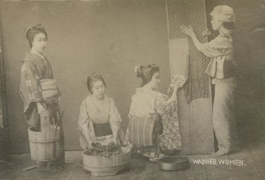 Women washing and drying clothes