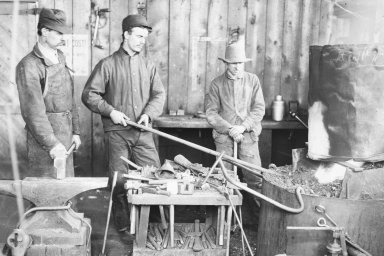 Men working in a smithy