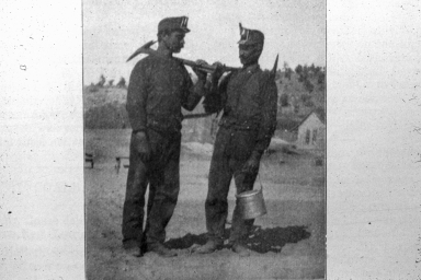 Two miners with pickaxes