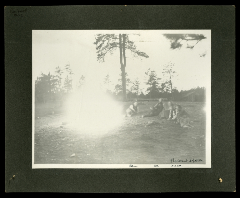 Theodore Cockerell, Wilmatte Cockerell, Rohwer, and two unidentified men around campfire at Florissant