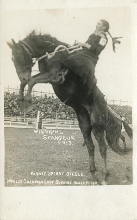 Fannie Sperry Steele riding a bronco