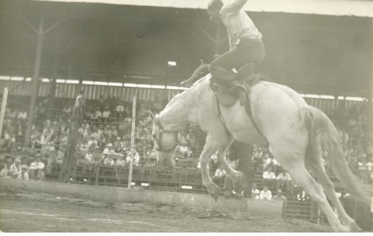 Leo Karstad riding bronco