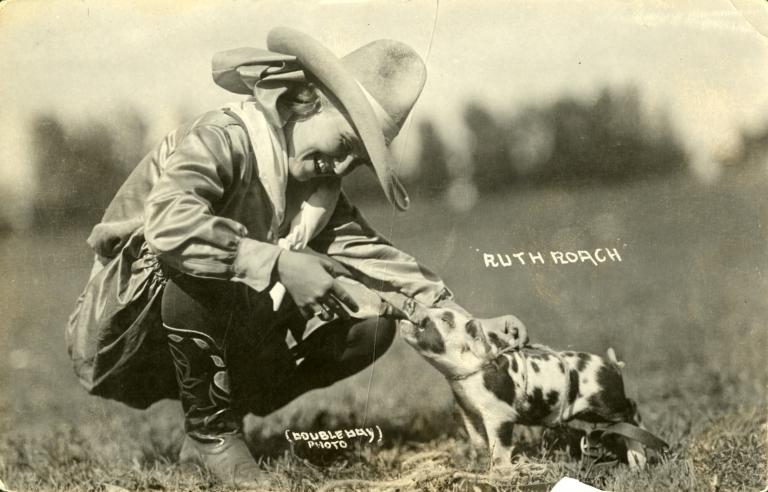 Ruth Roach feeding pig