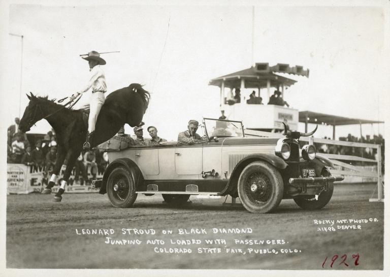 Leonard Stroud jumping horse over car