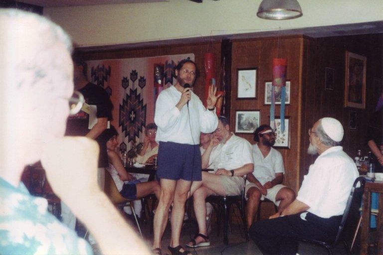 Rabbi David Wolfe-Blank speaking while Rabbi Zalman Schachter-Shalomi sits and listens, 07-24-1994