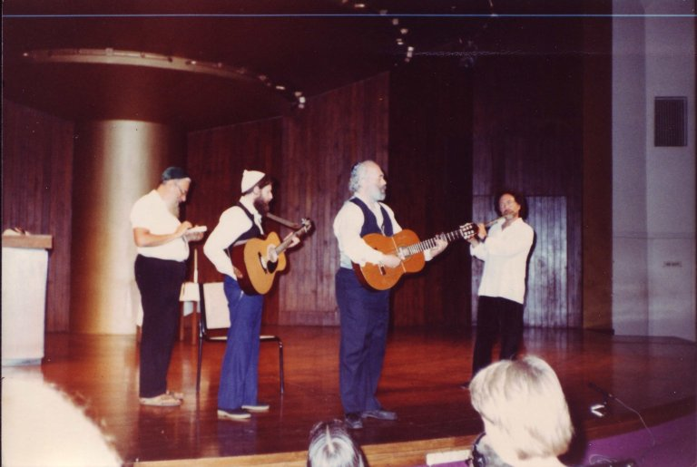 Rabbi Zalman Schachter, Rabbi Shlomo Carlebach, David Zeller and Paul Horn performing on stage at the Transpersonal Association Conference, 1982.
