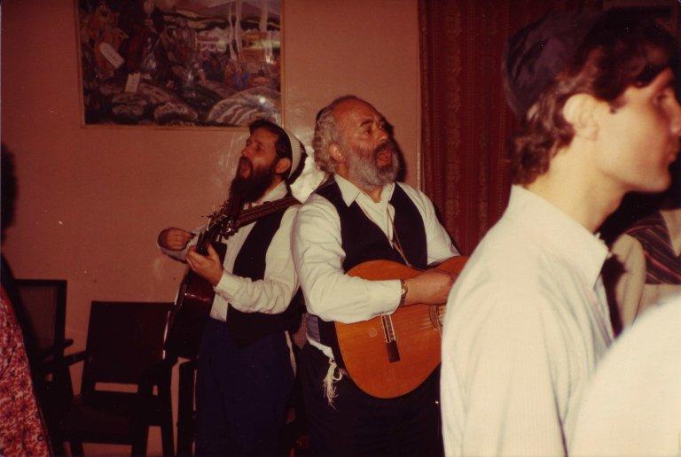 David Zeller and Rabbi Shlomo Carlebach performing for members of the Bombay Jewish community, 1982.