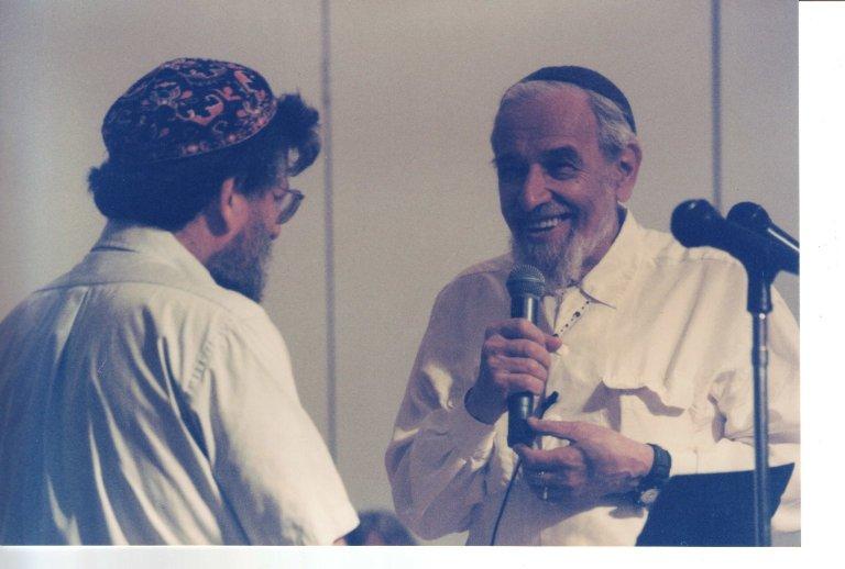 Rabbi Daniel Siegel and Rabbi Zalman Schachter-Shalomi on stage together, ca. 1990s.