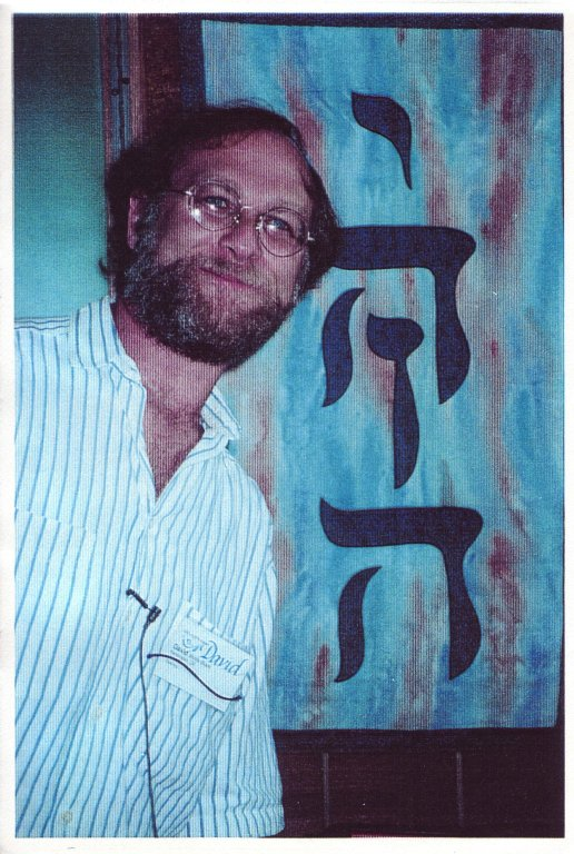 Rabbi David Wolfe-Blank with artword depicting the Divine Name, Y-H-V-H.