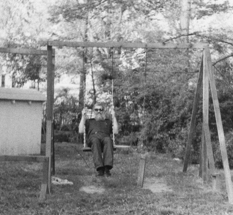 Rabbi Zalman Schachter on a swing, Fall 1990.