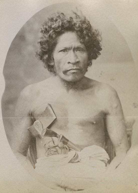 Man with axe, possibly Borneo