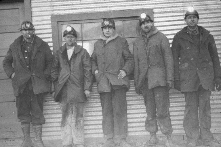 Five coal miners posing