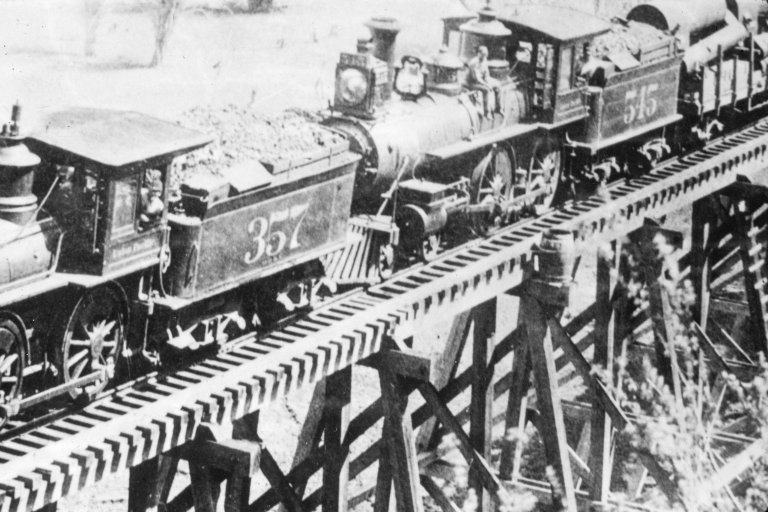 Two locomotives with coal cars