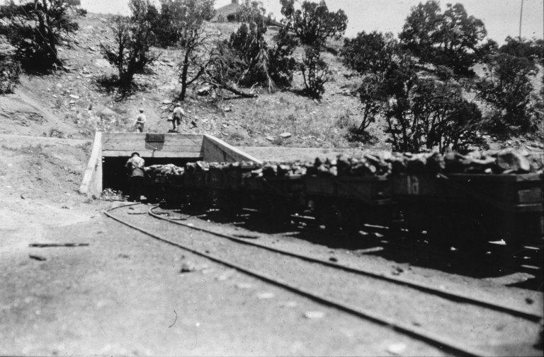 Loaded coal cars outside a mine