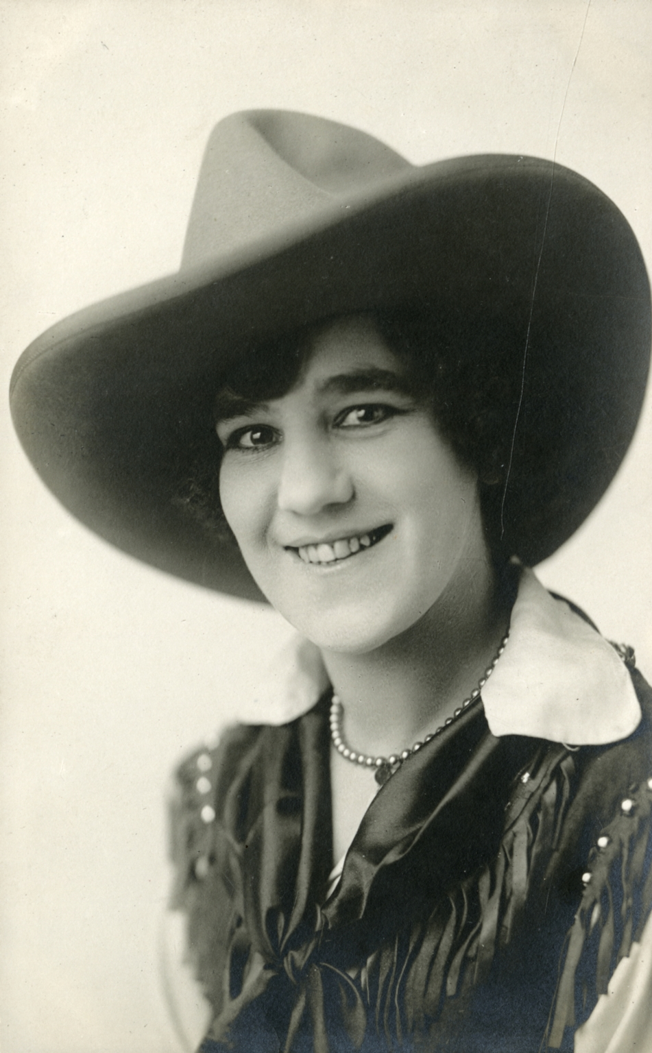 Portrait of unidentified woman rodeo performer