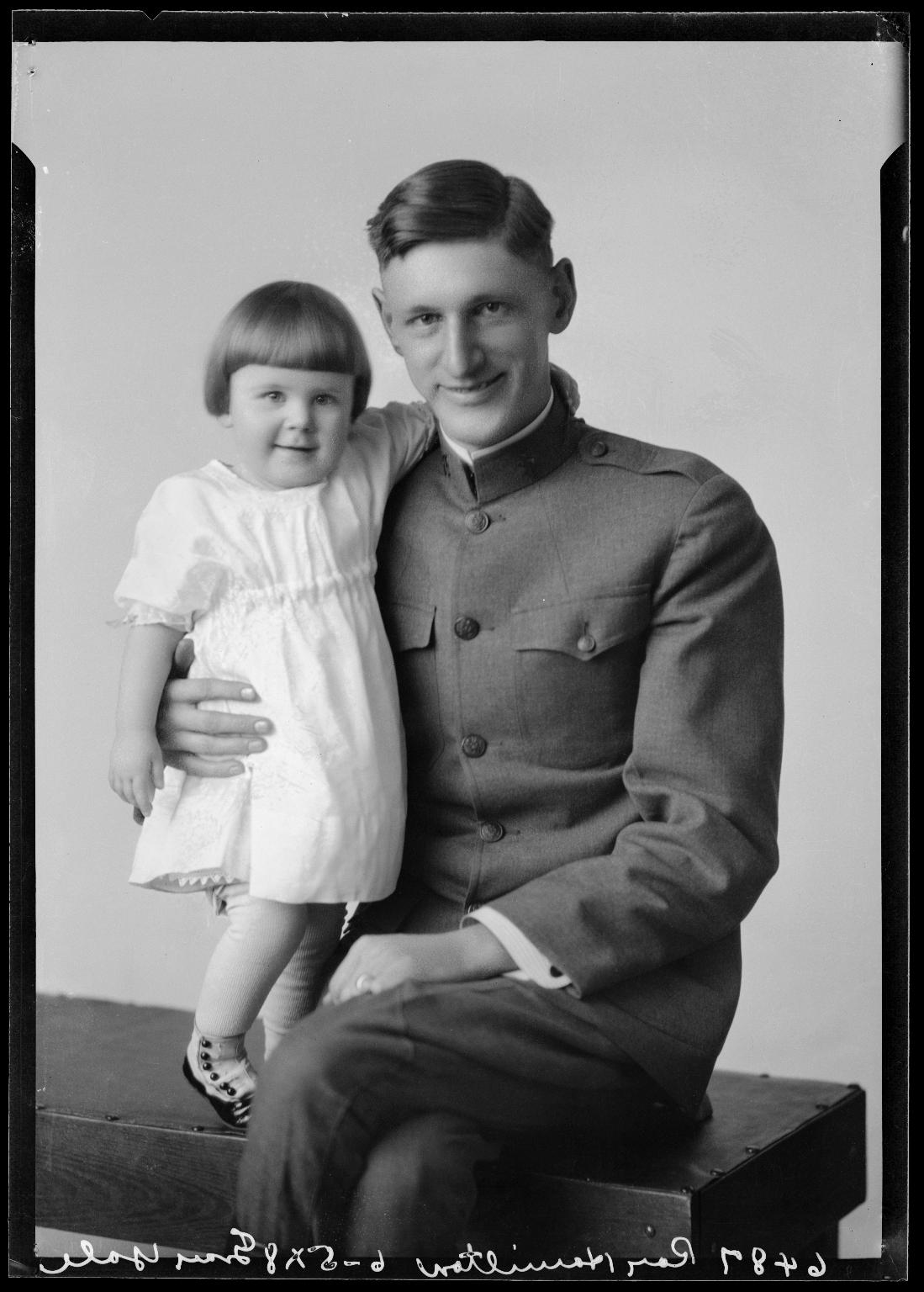 Portraits of Roy W. Hamilton and child