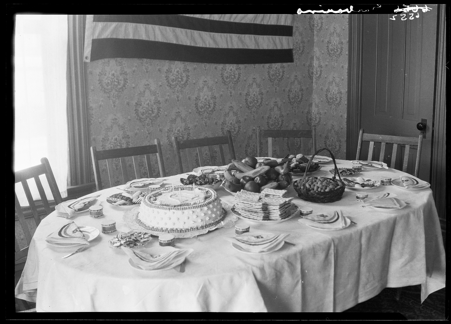 Belshe Garbarino's table set with food, with a group portrait of 10 children