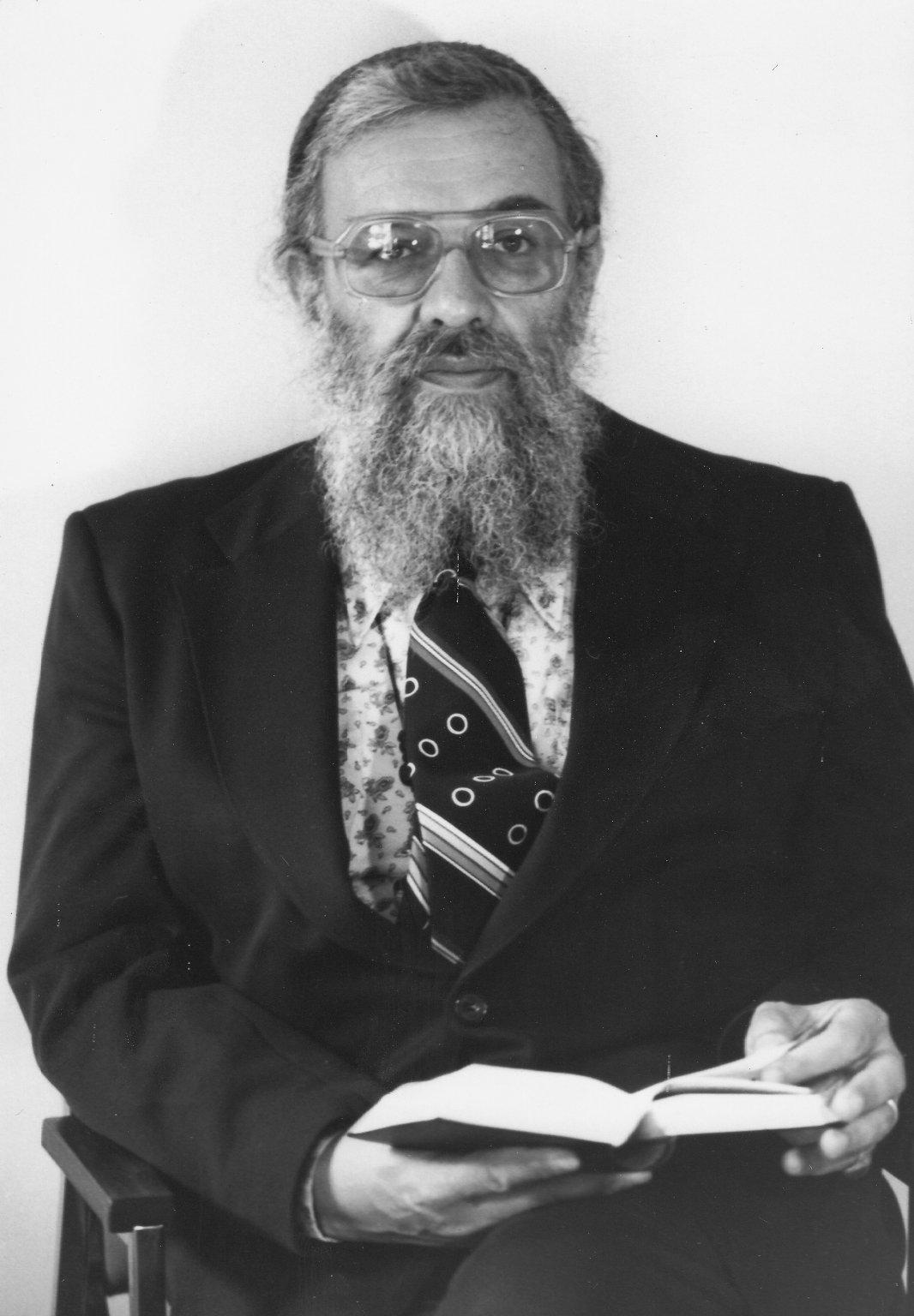Rabbi Zalman Schachter holding a book, ca. 1970s.
