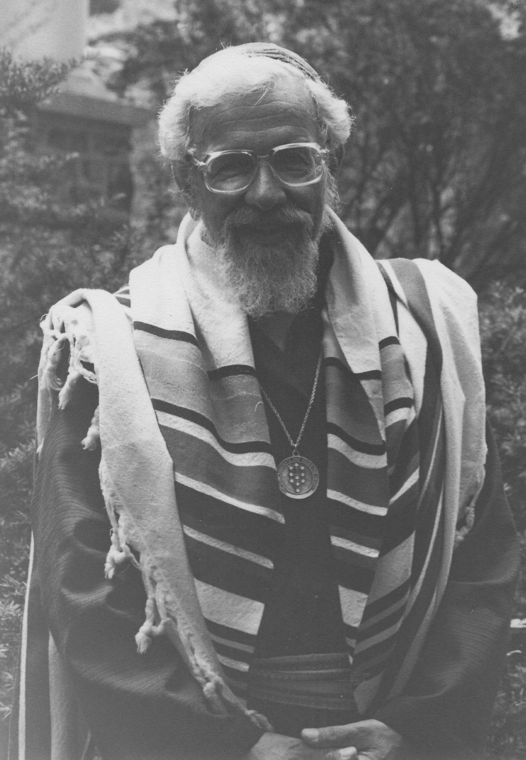 Rabbi Zalman Schachter-Shalomi in a robe with a tallit and B'nai Or medallion, ca. 1980s.