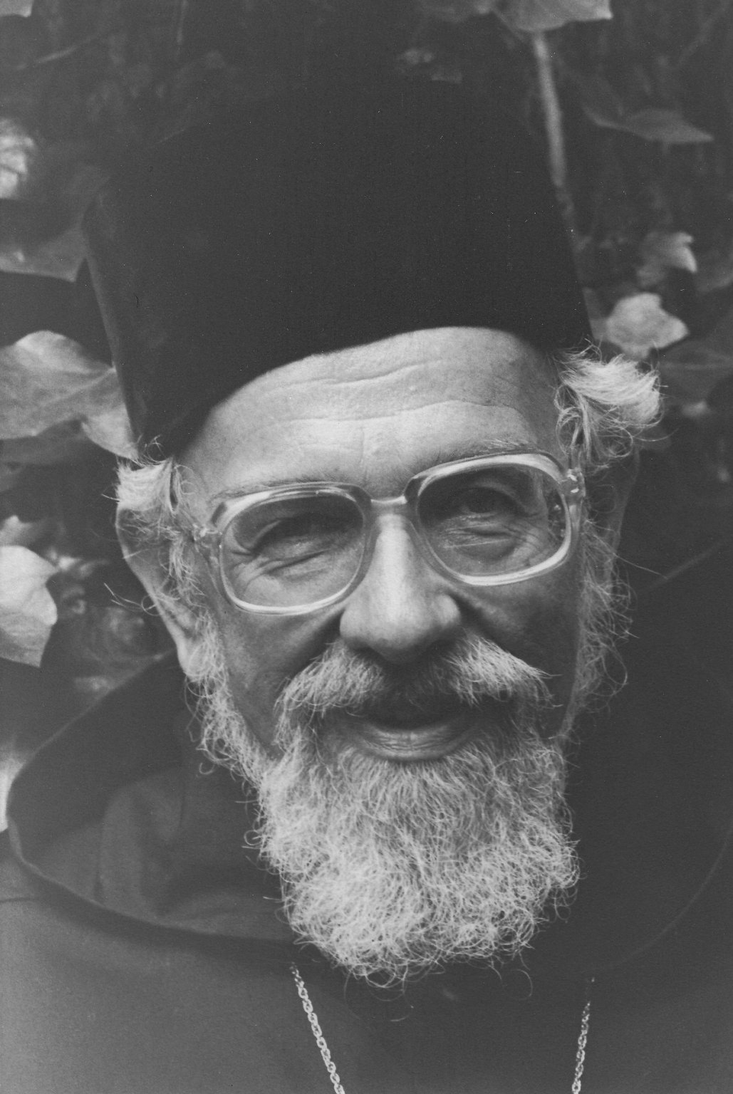 Rabbi Zalman Schachter-Shalomi in black robe and hat, ca. 1980s.