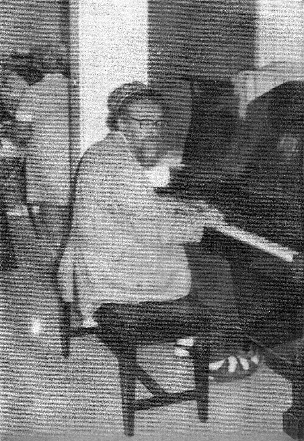 Rabbi Zalman Schachter playing the piano, ca. 1970s.