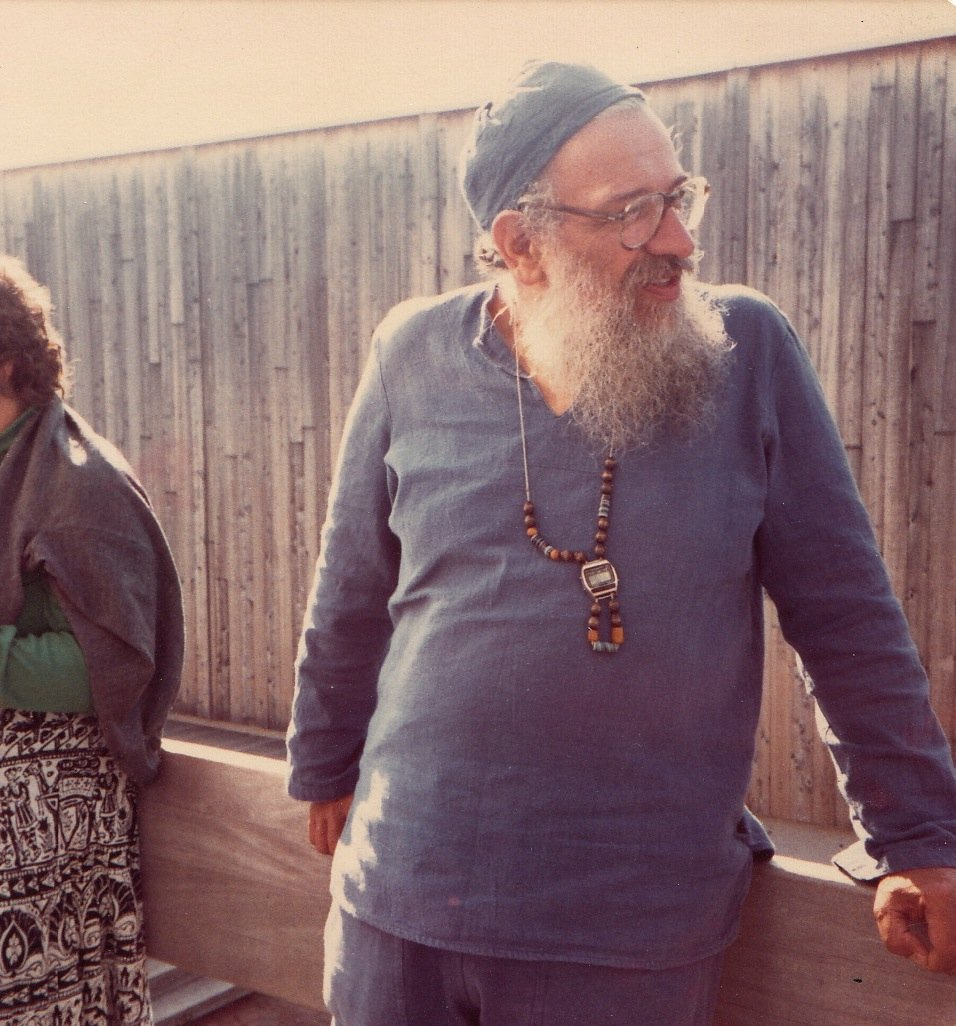 Rabbi Zalman Schachter in blue Deva Lifewear outfit with beaded watch-necklace, early 1980s.